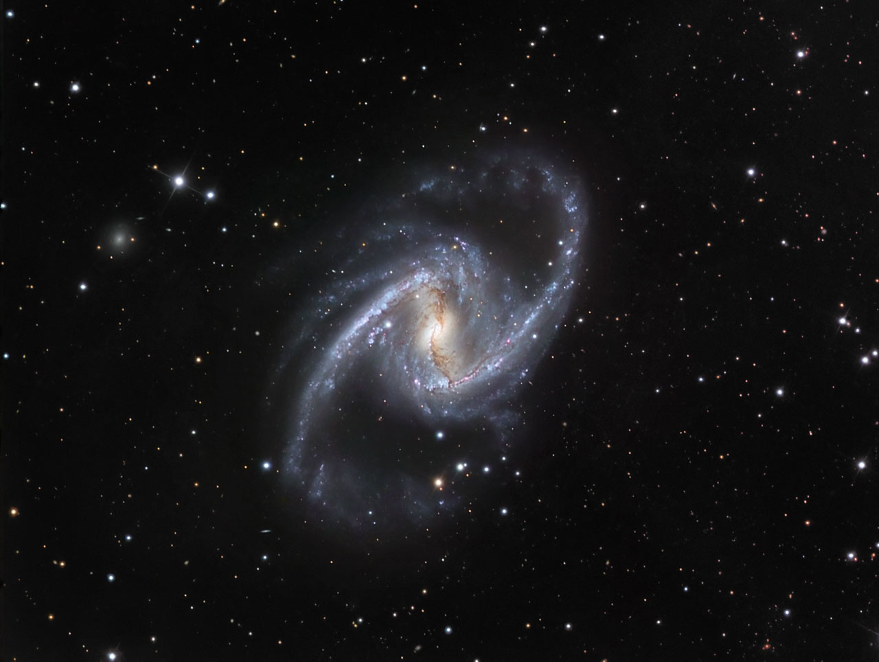Classic portrait of a barred spiral galaxy  ESAHubble